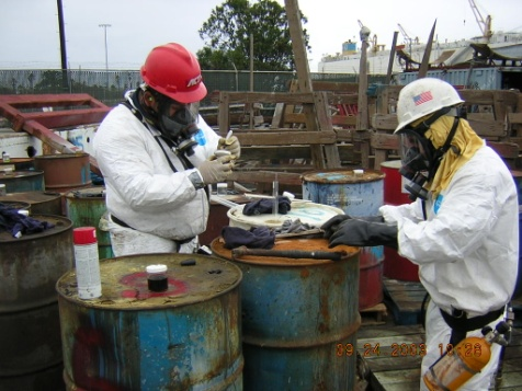 Workers in hazard suits